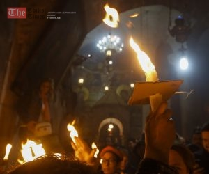 epa04700018 Christian Orthodox worshipers hold candles lighted from the first Holy Fire at the Church of the Holy Sepulchre, traditionally believed the site of the crucifixion and burial of Jesus Christ, 11 April 2015, the day before Orthodox Easter Sunday. Eastern Orthodox Christians believe the Holy Fire, which emenates from within the Tomb of Christ and quickly spreads around the church and outside to Jerusalem and even to foreign countries, represents the flame of the Resurrection power, as well as the fire of the Burning Bush of Mount Sinai.  EPA/ATEF SAFADI